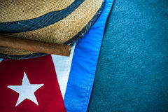 Straw hat with Cuban cigar and Cuban flag. Dark border background, vacation in Cuba check list concept Stock Image