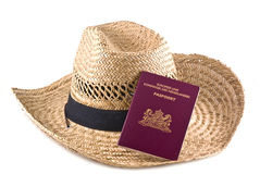 Straw hat with european passport. Stock Photos