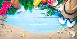 Straw hat with a exotic cocktail and sunglasses on sand beach. Summer Holidays concept royalty free stock photo