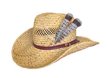 Straw hat with feathers isolated on white. Old cowboy or farmer style men's straw hat with two feathers and a hatband.  Isolated on white Stock Photos