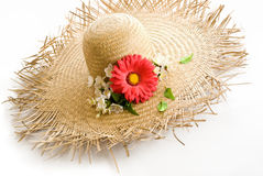 Straw hat with floral decoration. Over white background stock photos