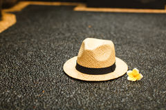 Straw hat with a flower. vacation concept stock photography