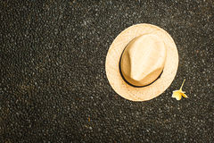 Straw hat with a flower. vacation concept stock photo