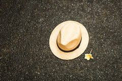 Straw hat with a flower. vacation concept royalty free stock photo