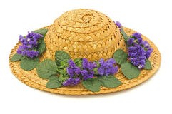 Straw hat with flowers Royalty Free Stock Images