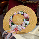 Straw Hat with Flowers Stock Photo