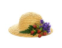 Straw hat with flowers  on white Royalty Free Stock Photography