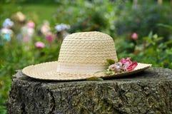 Straw hat in garden Stock Photos