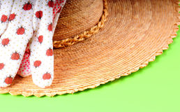 Straw hat and gardening gloves Stock Photography