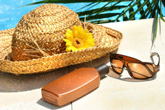 Straw hat, glasses and suntan lotion Stock Photography