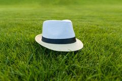 Straw hat on green grass lawn texture. Straw hat on green grass lawn texture royalty free stock photography