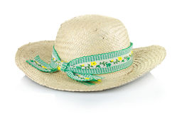 A straw hat with a green ribbon Stock Image
