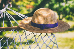Straw hat on a hammock Stock Image