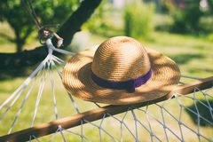 Straw hat on a hammock in a sunny summer day stock image