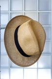 Straw hat hanging on a metal hanger. Stock Photography