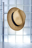 Straw hat hanging on a metal hanger. Royalty Free Stock Photos