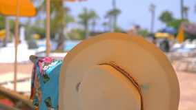 Hat on sun bed at beach