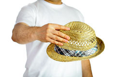 Straw hat hold by hand Stock Images