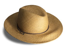 Straw hat isolated. Golden straw hat on white with shadow and clipping path royalty free stock photography