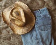 Straw Hat And Jeans fotografía de archivo