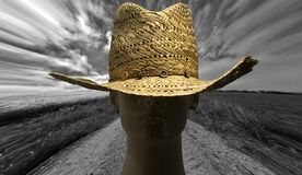Straw hat and landscape Stock Photo