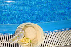 The straw hat lies on the brink of pool Stock Images