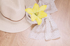 Straw hat, light scarf and jellied flower on wooden background. Things for trip or go out of town for weekend. Romantic mood Stock Photos