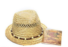 Straw hat and passport isolated on white Royalty Free Stock Photo