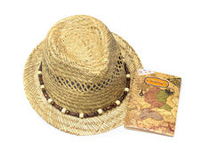 Straw hat and passport isolated on white Stock Image