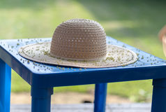 Straw hat on plastic table Stock Photo