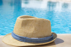 Straw hat by the pool Stock Image
