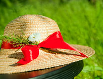 Straw hat with red ribbon in the grass Royalty Free Stock Image