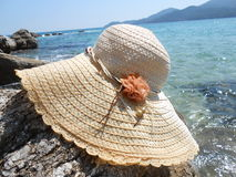Straw hat on the rock Royalty Free Stock Photo