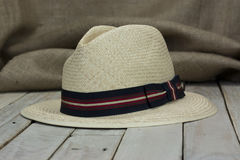 Straw hat on rustic surface Stock Photo