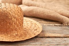 Straw hat on rustic wooden background. royalty free stock images