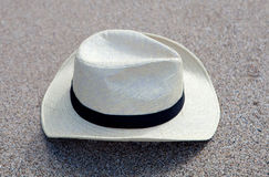 Straw hat on the sand Stock Images