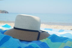 Straw hat on the sand near the shore on a beach in summer Stock Images