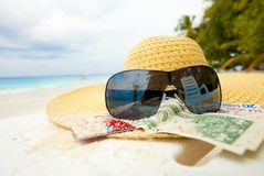 Straw hat, shades and money - all you need Stock Photo