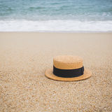 Straw hat on the shore of a beach Royalty Free Stock Images