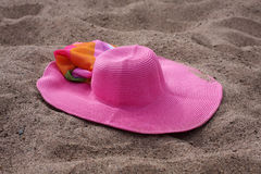 Straw Hat and silk shawls on sand Stock Images