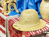 Straw hat on slavic linen, handmade. Culture of Belarus. Royalty Free Stock Photography