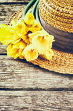 Straw hat with spring flowers Stock Photography