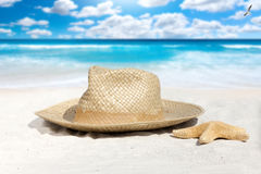 Straw Hat and Starfish on the Beach Stock Photography