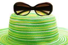 Straw hat and sunglasses Stock Photography