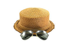 Straw hat and sunglasses Stock Photos