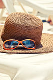 Straw hat with sunglasses Royalty Free Stock Photos