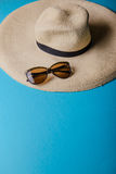 Straw hat and sunglasses Stock Photo