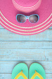 Straw hat and sunglasses on blue wood.Summer holiday background Royalty Free Stock Photography