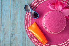 Straw hat and sunglasses on blue wood.Summer holiday background Royalty Free Stock Images
