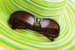 Straw hat and sunglasses Royalty Free Stock Image